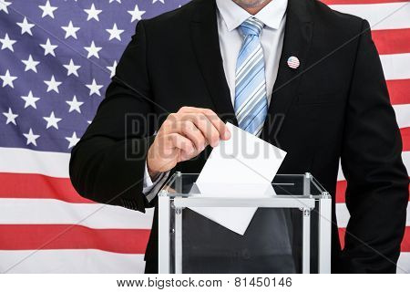 Person Putting Ballot In Glass Box
