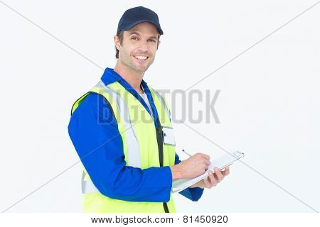 Portrait of handsome supervisor writing notes on clipboard over white background