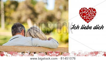 Elderly couple sitting on the bench with their back to the camera against ich liebe dich