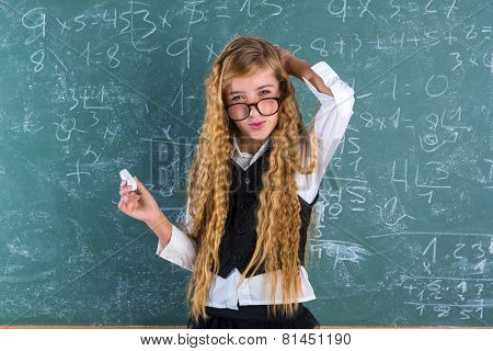 Clever nerd pupil blond girl in green board student difficult expression schoolgirl