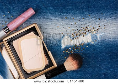 Still Life From Cosmetics On Ragged Jeans With Rhinestones