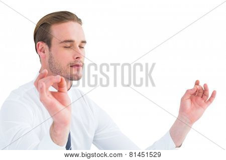 Relaxed businessman in shirt mediating on white background