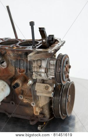Close-up of old car engine on white background
