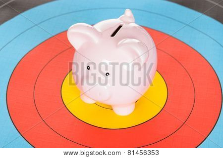 Piggy Bank Over Dartboard