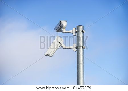 Twin Security Cameras On A Pole