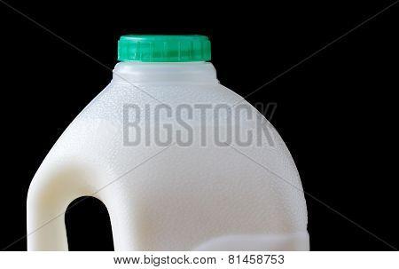 Top of full plastic milk bottle