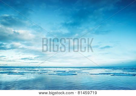 Winter Coastal Landscape With Floating Ice Fragments And Sky
