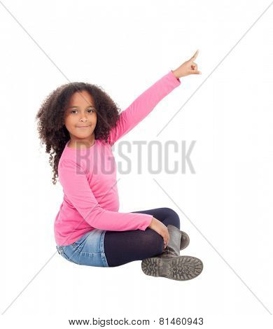 Adorable african little girl indicating something with her finger isolated on white background