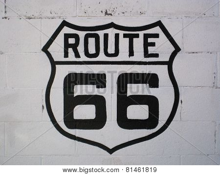 Route 66 sign on a white wall in Williams (Arizona)