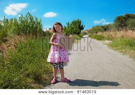 little girl hitchhiking along the street, portrait