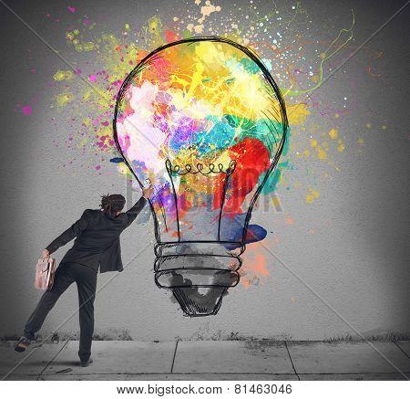 Colors a lightbulb