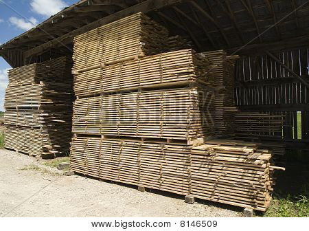 stacked timber under cover