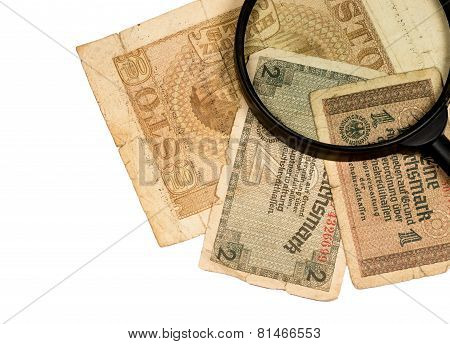 Reichsmarks Bill Of Germany Polish Zloty And Magnifier Isolated On White