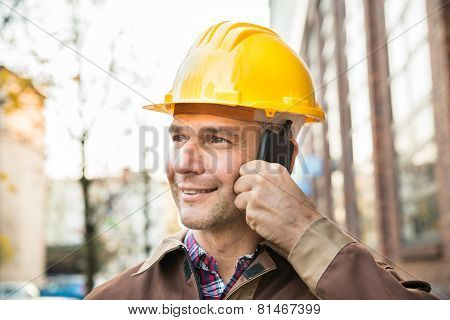 Builder Wearing Hardhat Talking On Walkie Talkie