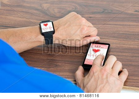 Male Hand With Smartwatch And Cellphone
