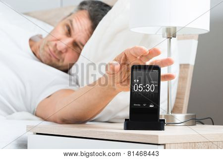Man On Bed With Cell Phone