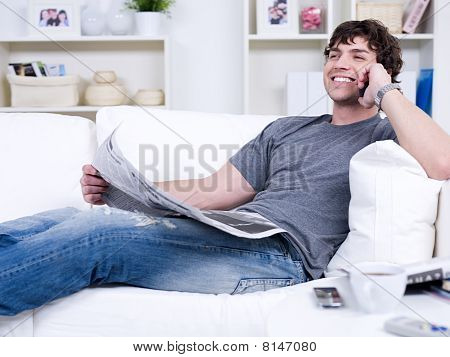 Man With Phone And Newspaper
