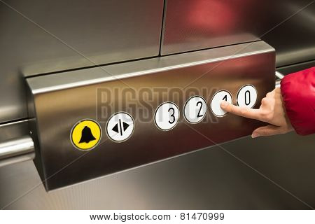 Hand Pressing First Floor In Elevator