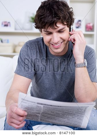 Happy Man With Newspaper
