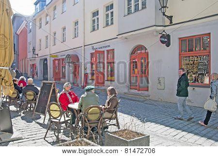 Tallinn. Estonia. Mature people in open air cafe. Old Town