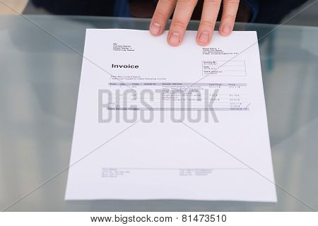 Person's Hand With Invoice
