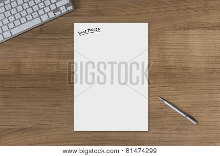 Blank Sheet Due Dates On A Wooden Table