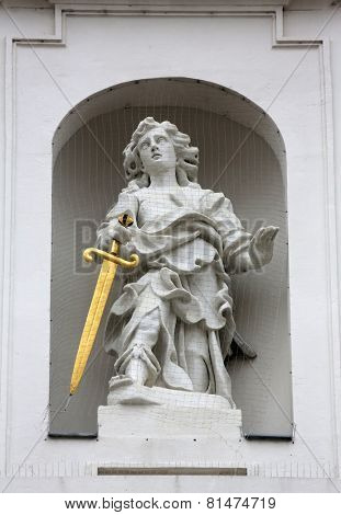 VIENNA, AUSTRIA - OCTOBER 11: Statue of Saint, Church of the nine choirs of angels is a 1386-1403 established church in Vienna, Austria on October 11, 2014.