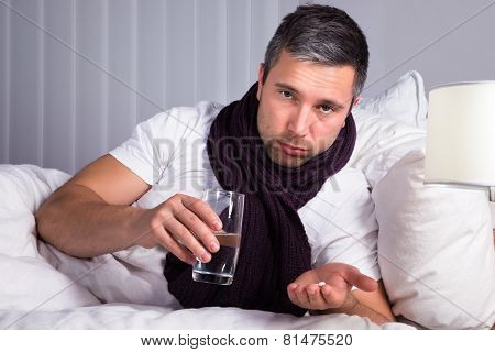 Sick Man Taking Medicines
