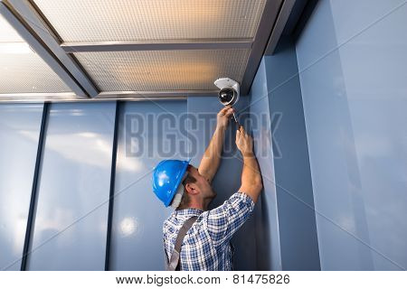Cctv Technician Fixing Camera