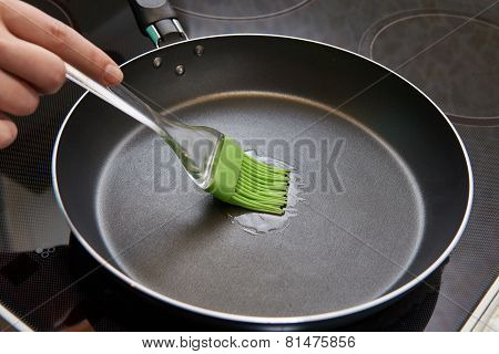 Brush With Sunflower Oil In Frying Pan