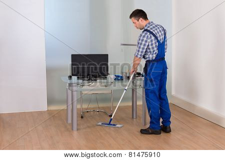 Man Cleaning Floor In Office