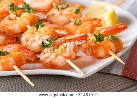 Delicious Fried Shrimp On Wooden Skewers Close-up Horizontal