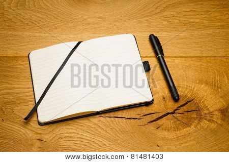 Empty Pages Notebook Marker Skew On Desk