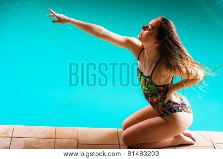 Woman In Swimsuit Pointing With Finger