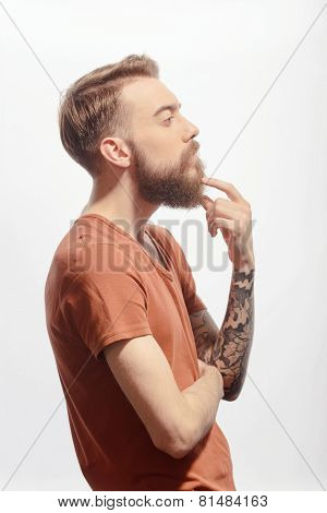 Handsome bearded man posing on white