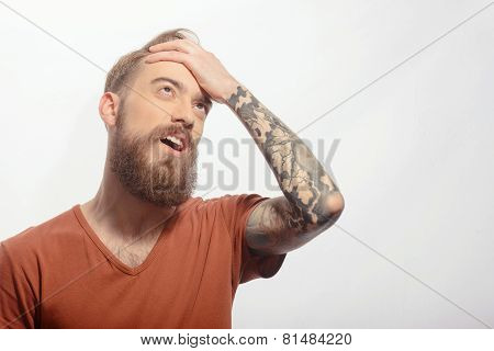 Handsome bearded man with headache
