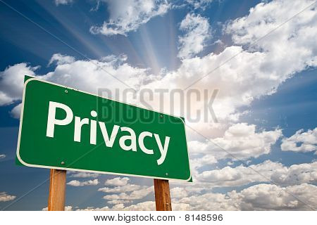 Privacy Green Road Sign Over Clouds