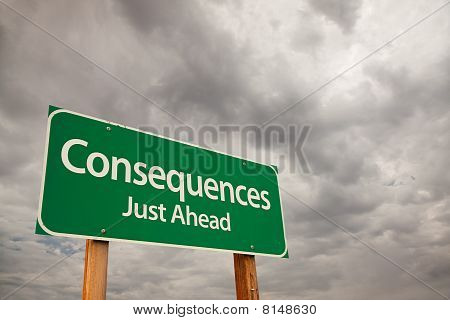 Consequences Green Road Sign Over Storm Clouds