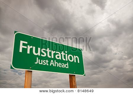 Frustration Green Road Sign Over Storm Clouds