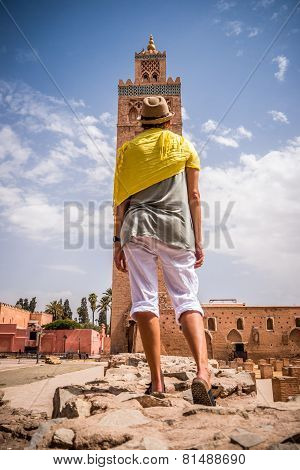 Woman Tourist Stands Looking Toward Middle Eastern Mosque.