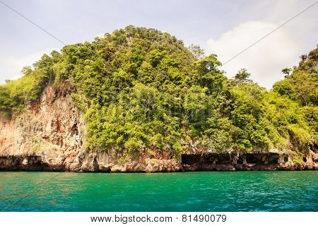 Cliffy Island In Azure Sea Water