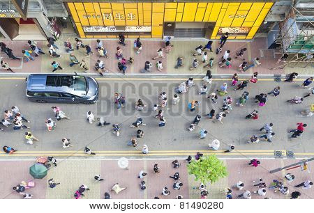 Pedestrians walking on a street, high angle view