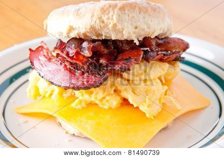 Hearty Egg, Cristpy Bacon, Cheese Sandwich On A Homemade Buttermilk Biscuit