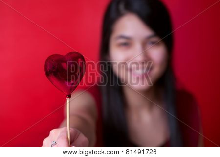 Beautiful Biracial Young Teen Girl Holding Heart Balloon, Smiling.