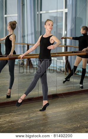 Young girls exercising during ballet class