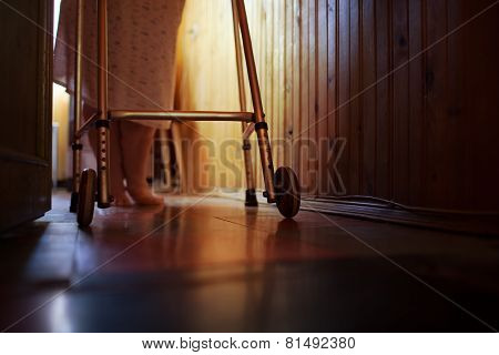 Senior woman using walker at home