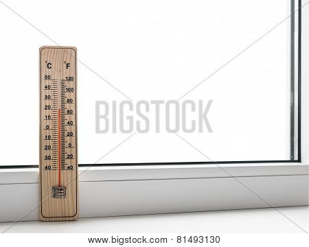 Thermometer On A Frozen Window