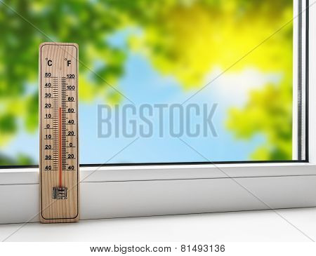 Thermometer On The Windowsill On The Background Of The Summer Heat