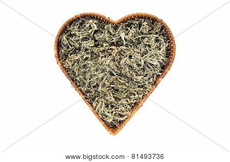 Dry Absinth Wormwood Medical Herbs In Heart Form Basket Isolated
