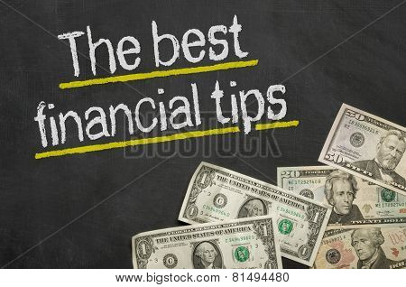 Text on blackboard with money - The best financial tip